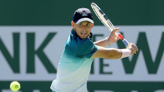 Dominic Thiem of Austria returns a shot to Milos Roanic at the Indian Wells Masters.(AFP)