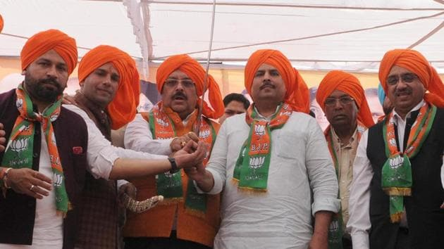 Organised by the Bharatiya Janata Yuva Morcha (BJYM), the rally saw all senior leaders, including state BJP president Shwait Malik, minister of state for social justice and empowerment Vijay Sampla and Phagwara MLA Som Parkash, addressing the public in saffron turbans.(HT Photo)