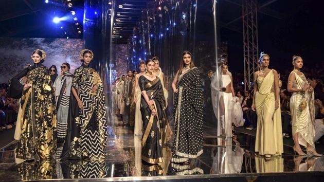 Bollywood actors Aditi Rao Hydari, Diana Penty and other models walk the ramp at the grand finale of India Fashion Week, in New Delhi, Sunday.(PTI)