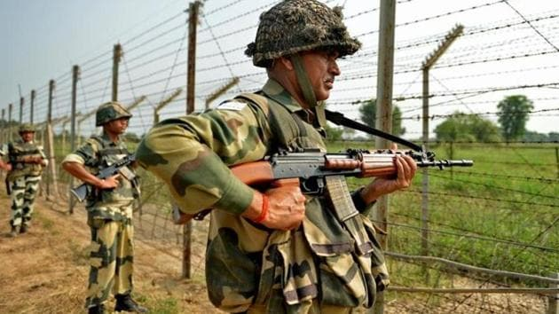 Indian Border Security Force (BSF) soldiers take up positions at an outpost along a fence at the India-Pakistan border in R.S Pora south-west of Jammu on October 2, 2016. Image for representation.(AFP file photo)