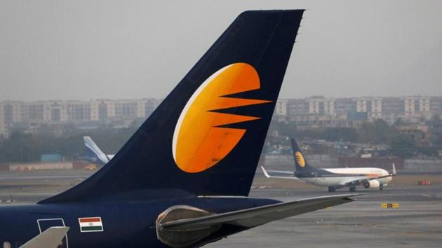 A Jet Airways plane is parked as another moves to runway at the Chhatrapati Shivaji International airport in Mumbai on February 14.(REUTERS)