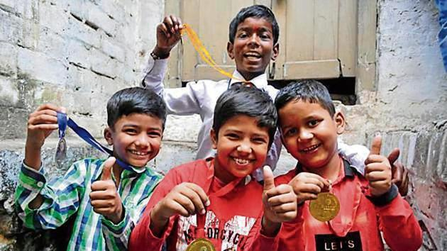 Ali Ahmad (centre), Saksham (right), Abdullah (left) and Krishna (back) – students who did well in their exams.(Deepak Gupta/HT Photo)
