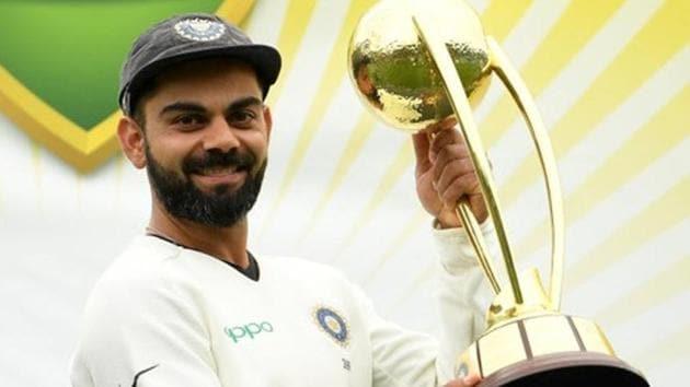 Virat Kohli lifts the Border-Gavaskar Trophy as they celebrate a 2-1 series victory over Australia.(REUTERS)