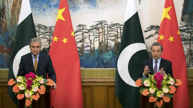 Chinese foreign minister Wang Yi with his Pakistani counterpart Shah Mahmood Qureshi during a joint press conference at the Diaoyutai State Guesthouse in Beijing on March 19.(AP Photo)