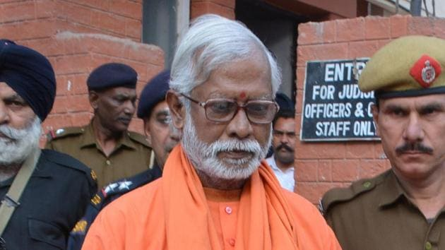 Swami Aseemanand seen outside NIA Court, in Panchkula on March 18.(HT File Photo)