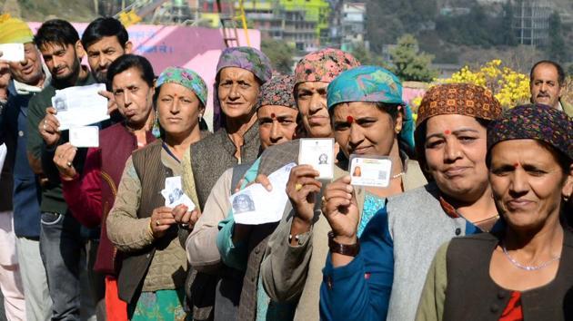 Women show their voting cards before casting their vote at Theog in Himachal Pradesh's Shimla district.(Deepak Sansta / HT Photo)