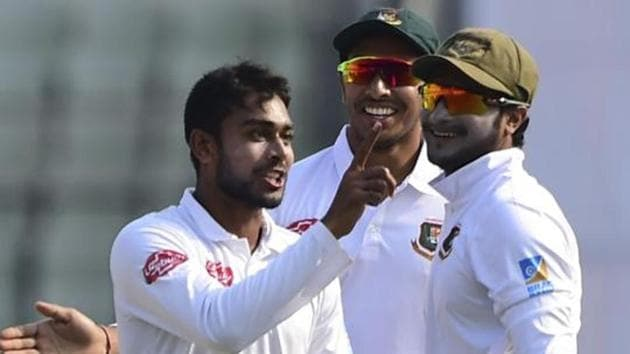 Bangladeshi cricketer Mehidy Hasan (L) celebrates with teammate Shakib Al Hasan (R) after the dismissal of West Indies cricketer Shimron Hetmyer during the third day of the second Test cricket match between Bangladesh and West Indies at the Sher-e-Bangla National Cricket Stadium in Dhaka.(AFP)