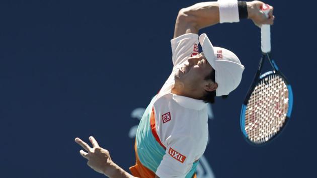 Kei Nishikori of Japan serves against Dusan Ljovic of Serbia.(USA TODAY Sports)