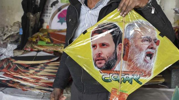 A kite maker shows a kite with images of Prime Minister Narendra Modi and Congress president Rahul Gandhi.(PTI file photo)