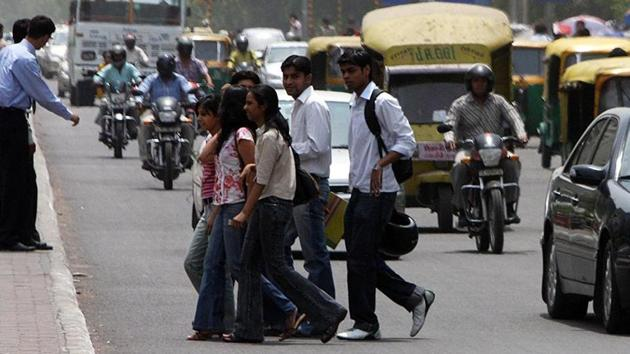 Students walk the most. But too many vehicles, encroachments and poor pedestrian infrastructure often make the walking routes to educational institutions, barring a few university campuses, unsafe.(HT File Photo)