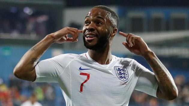 England's Raheem Sterling celebrates scoring their fifth goal against Montenegro.(Reuters)