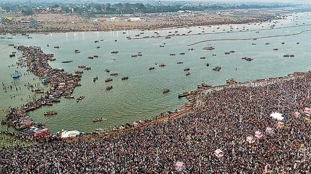 Thousands of pilgrims take a ritualistic dip at the Sangam, during the Kumbh.(AP File Photo)