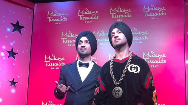 Diljit Dosanjh with his wax statue at Madame Tussauds New Delhi.