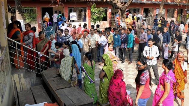 Raipur: Voters stand in a queue at a polling station to cast their votes for the 2nd phase of Assembly elections, in Raipur, Tuesday, Nov.20, 2018. (PTI Photo)(PTI11_20_2018_000040B)(PTI)