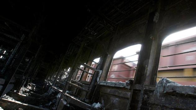 A view of a burnt carriage of Samjhauta Express train in Deewana, near Panipat town, February 19, 2007. REUTERS/Desmond Boylan/File Photo(REUTERS File)