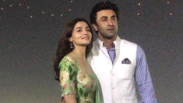 Actors Alia Bhatt and Ranbir Kapoor with a backdrop of their upcoming film logo Brahmastra at Sangam - the trinity of rivers Ganga, Yamuna and the mythical Saraswati, on the occasion of Maha Shivratri during Kumbh Mela.(IANS)