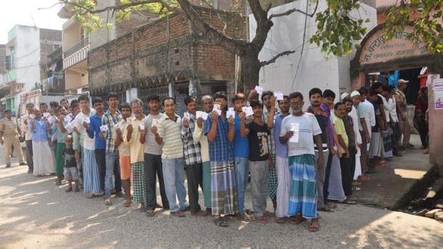 Bihar, India – Voters wait in a long queue to cast votes during the first phase of Bihar Assembly polls, outside a polling booth at Champanagar Tanti Bazar of Nathnagar, in Bihar, India on Monday, October 12, 2015. *Elections*(HT Photo)