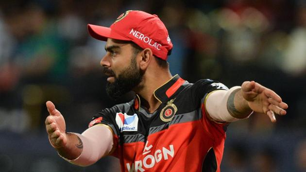 Royal Challengers Bangalore captain Virat Kohli gestures during the 2019 Indian Premier League (IPL) Twenty20 cricket match between Royal Challengers Bangalore and Mumbai Indians(AFP)