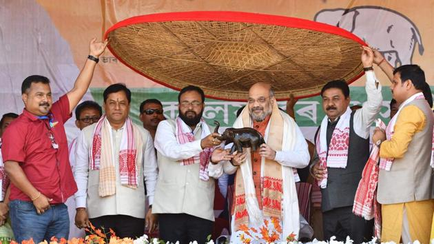 """The BJP will conduct a citizenship screening exercise in Bengal to identify and weed out infiltrators, party president Amit Shah said at a public rally in Alipurduars, West Bengal on Friday. """"We want to assure each and every Hindu refugee that none has to leave the country. All of you will have a place to live in India with respect. The Citizenship Amendment Bill is our commitment,"""" said Shah. (Biju Boro / AFP)"""
