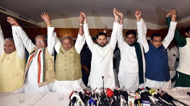 Rashtriya Janata Dal leader Tejashwi Yadav, Hindustani Awam Morcha (Secular) Chief Jitan Ram Manjhi and other leaders join hands after announcing the grand alliance's candidates list for the upcoming Lok Sabha elections 2019, in Patna on March 29, 2019.(PTI Photo)