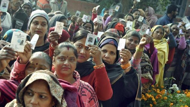 Patiala: Voters show their voting cards as they wait in queues to cast vote in Panchayat Polls, in Patiala, Sunday, Dec. 30, 2018. (PTI Photo) (PTI12_30_2018_000118B)(PTI)
