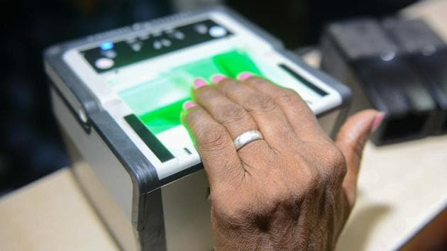 A woman getting her fingerprints read during the registration process for Aadhaar cards in Amritsar.(AFP File Photo)