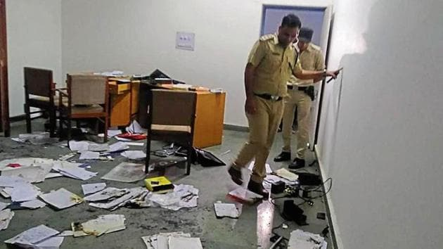 Cops examining the spot at the juvenile detention centre in Madhuban, Karnal, on Sunday, March 31, 2019.(HT Photo)