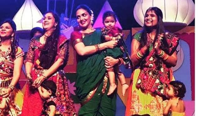 Esha Deol dancing with daughter Radhya on stage.