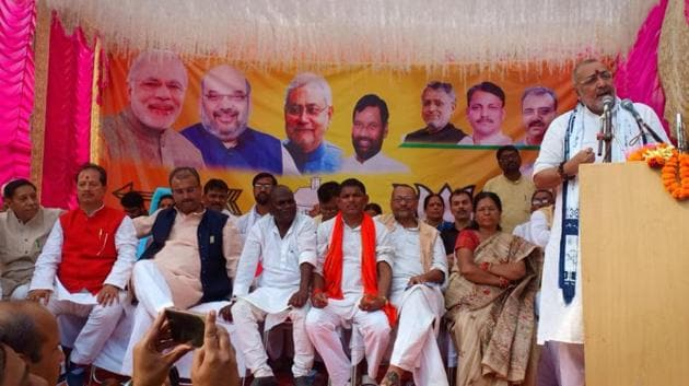 Union minister Giriraj Singh addresses a poll meet in Begusarai on Saturday. Manju Verma, who is on bail in a case regarding sexual abuse of minor girls at a shelter home, is seen seated.(HT PHOTO)