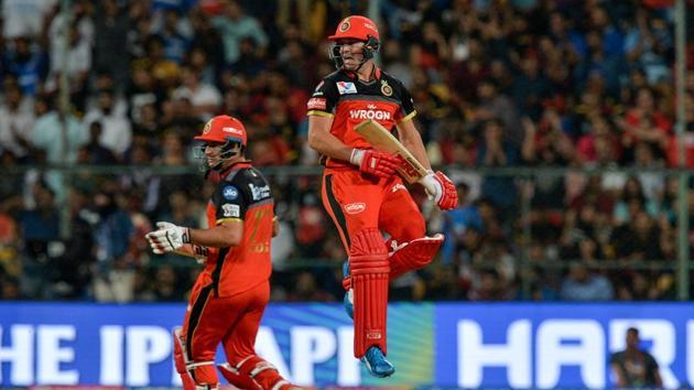 AB De Villiers (R) jumps to celebrate a sixer as his teammate Colin De Grandhomme looks on.(AFP)