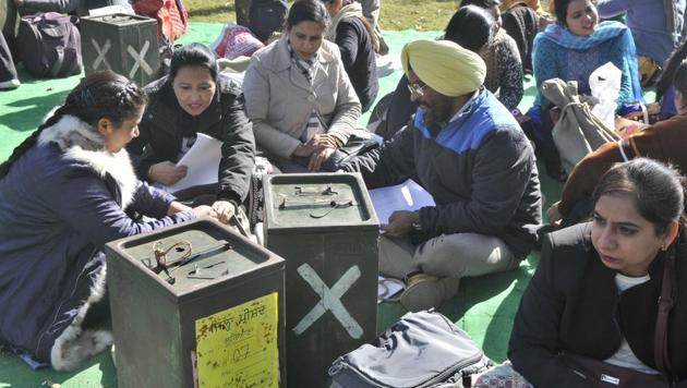 Polling staff checking poll material ahead of December 2018 Gram Panchayat elections in Ludhiana .(HT file photo)