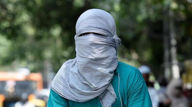 A person is seen completely covered as they venture out in the sun.(PICTURE FOR REPRESENTATIONAL PURPOSES ONLY)