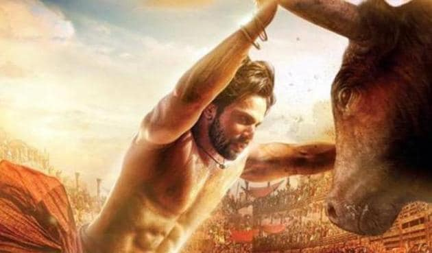 Varun Dhawan in a poster from Kalank where he is seen taking on a bull.