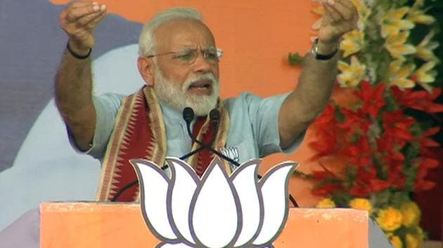 Prime Minister Narendra Modi addresses public rally in Kalahandi on Tuesday.(ANI Photo)