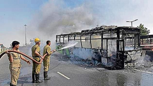 The bus was on its way to Mori gate from Rajghat when it caught fire.(HT Photo)