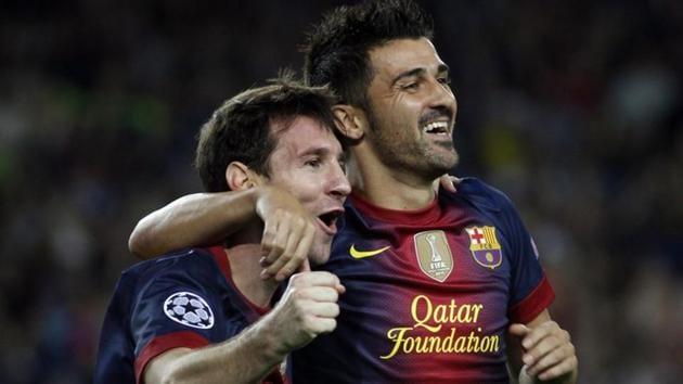 Barcelona's Lionel Messi and David Villa celebrate a goal on September 19, 2012.(REUTERS)