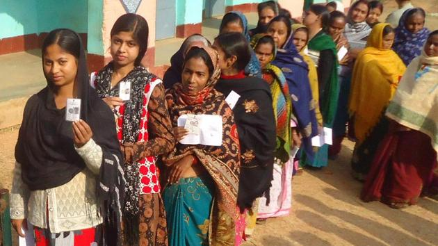 Dumka , Jharkhand, INDIA – December 20: Voters queue waiting to cast their votes on 5th phase election of Jharkhand assembly poll for Santhal Praganna at a polling booth in Dumka on Saturday December 20, 2014(Hindustan Times)