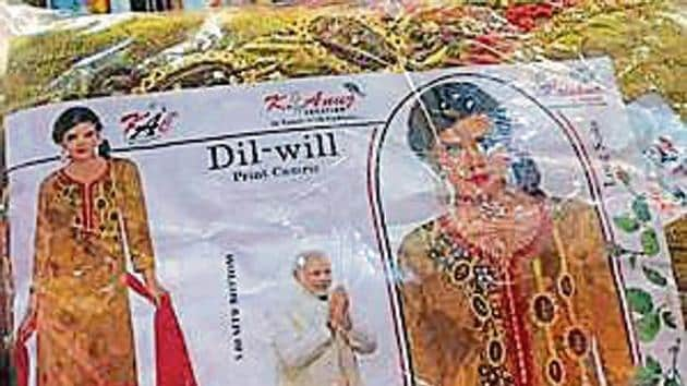 Apart from the BJP's symbol, party slogans such as 'acche din aane wale hai' were also found on some packages.(HT Photo)