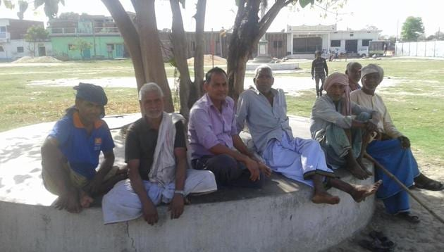 Residents of Gahmar village in Ghazipur discussing prospects of various parties in Lok Sabha elections(HT)