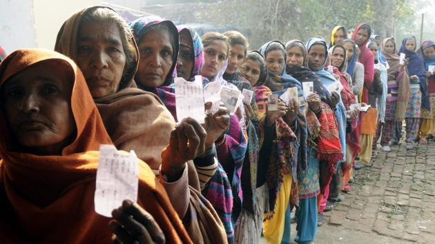 Patiala, India-30 December 2018::::::voters showing Voter Slips before casting her vote during the panchayati election at Dharamkot village in Patiala on Sunday, December 30, 2018.(Bharat Bhushan Hindustan Times.)