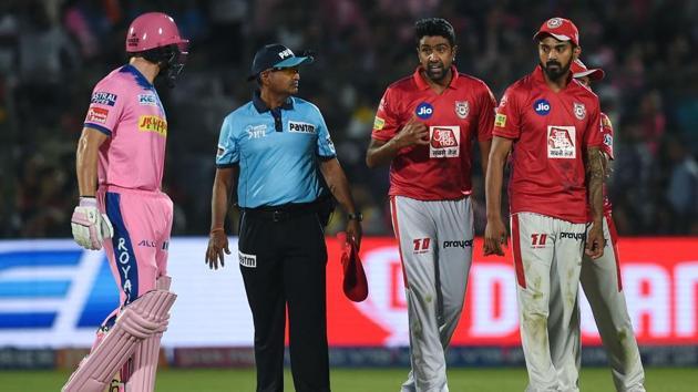 Rajasthan Royals' Jos Buttler (L) exchanges words with Kings XI Punjab's Ravichandran Ashwin (2nd R).(AFP)
