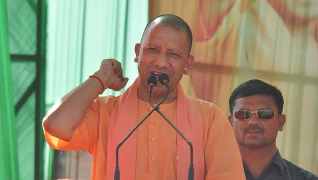Uttar Pradesh Chief Minister Yogi Adityanath addresses an election rally to campaign for BJP candidates ahead of the Lok Sabha elections, at Loni, in Ghaziabad, India, on Wednesday(HT)