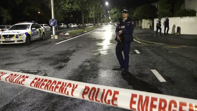 A police officer patrols a cordon near a mosque in central Christchurch, New Zealand. The main accused gunman will face 50 murder charges in his next appearance in court on Friday.(AP)