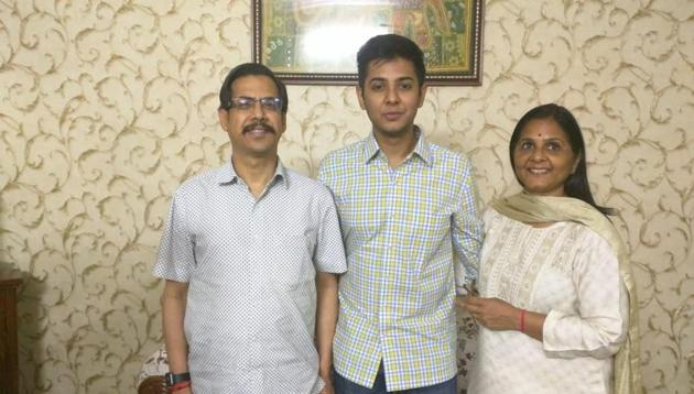 Akshat Jain, who got the second rank in UPSC CSE exam, with his father DC Jain and mother Simmi Jain.(HT photo)