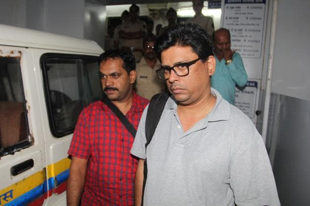 Arun Ferreira (in Grey), a human rights activist and lawyer was been arrested by Pune police in January 2018, in connection with caste-related violence erupting at Bhima-Koregaon near Pune.(HT PHOTO)