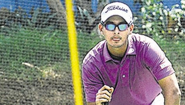 PRookie teenager Kshitij Naveed Kaul from Delhi in action during the Pune Open Golf Championship 2019 at the Poona Club Golf Course on Thursday.(SHANKAR NARAYAN/HT PHOTO)