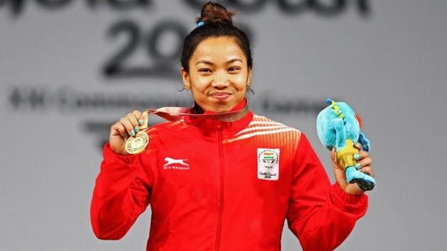 Gold medalist, Chanu Saikhom Mirabai of India celebrates on the podium after the Weightlifting Women's 48kg Final on day one of the Gold Coast 2018 Commonwealth Games at Carrara Sports and Leisure Centre on April 5, 2018 on the Gold Coast, Australia.(Getty Images)