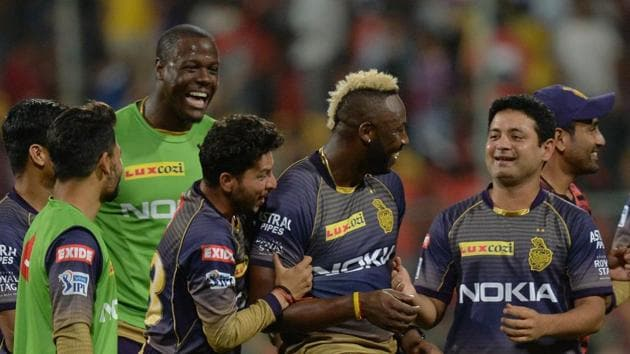 Kolkata Knight Riders teammates greet batsman Andre Russell (C-R) after he led the team's victory during the 2019 Indian Premier League (IPL) Twenty20 cricket match between Royal Challengers Bangalore and Kolkata Knight Riders(AFP)