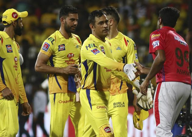 Chennai Super Kings captain Mahendra Singh Dhoni, second right, shakes hands with Kings XI Punjab captain Ravichandran Ashwin, right, after their win.(AP)