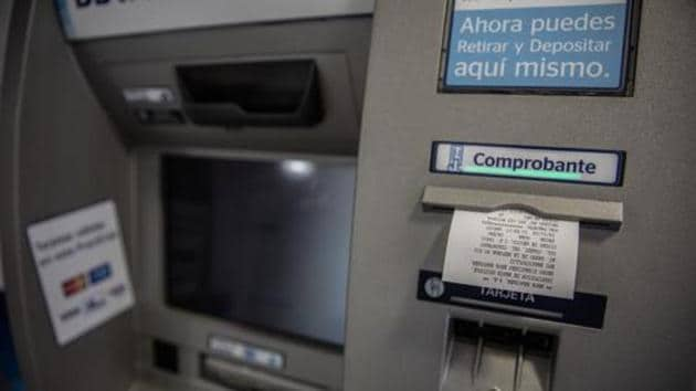 A group of unidentified thieves allegedly cut open an ATM belonging to a private bank, stole Rs 16.77 lakh, and then set fire to it in Sector 38's Jharsa village on Thursday morning.(Bloomberg File Photo)